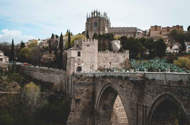 photo of gray castle and bridge